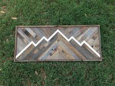 Rustic Mountain Wall Art Scene made with various shades of reclaimed wood and white mountain outline.