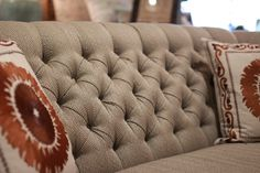 Abode Fine Living | gray-cream couch | cinched couched | couch detail | home accent | living room accent  | pop of orange