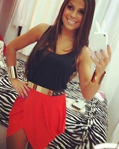 Red skirt, black tank top and golden belt