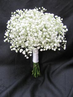 Bridesmaids bouquet of babies breath- simple but pretty, and affordable.