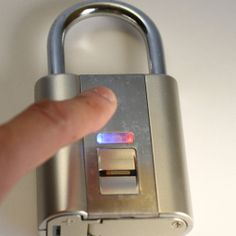 Fingerprint Padlock - Now you do not have to choose between losing your keys or getting robbed! http://dudebrogifts.com/fingerprint-padlock/