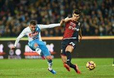 Napolis player Emanuele Giaccherini vies with Genoa CFC player Ezequiel Munoz during the Serie A match between SSC Napoli and Genoa CFC at Stadio San Paolo on February 10, 2017 in Naples, Italy.