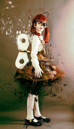 Steampunk Wind-Up Doll - little girl in doll costume; dress…