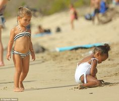Trendy tot: Penelope, three, looked equally stylish in a striped bikini which featured a pretty halter neck design