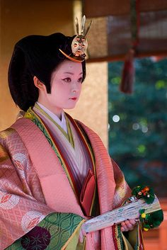 Dressed in 12 layers of kimono, official court costume of the Heian period, just like a Genroku-bina doll