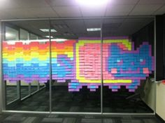 Another masterpiece from the Austin office. If don't know who Nyan Cat is, this piece will make about as much sense as a hybrid cat/pop-tart that travels the universe on a rainbow. If you're unfamiliar (and feeling brave), you may want to Google the YouTube video (with over 73 million views), so you can fully appreciate its artistic merit. Apparently, some of our Austin Gators got their hands on a pad or two of colored Post-It notes and, well, this happened.
