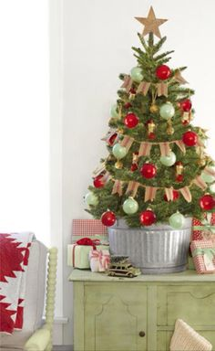 This mini Christmas tree brings major country charm thanks to its burlap banner, galvanized bucket, and lantern ornaments.