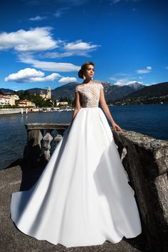 Simona - White Desire - MillaNova Splendid wedding gown Simona is made of exclusive Mikado fabric and delicate gauze decorated with a symmetrical lace pattern on the corset. The dress is beautifully fastened from the waist to the bottom with delicate covered up buttons. Hem falls to the floor.