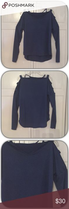 NWT Navy Blue Cold Shoulder Ladder Sleeve Top This is an amazing top! I love the sleeves! And this is a very pretty color! It is a Hi-lo top! Bust 21 front Length 25 Back 29 Boutique Tops Tees - Long Sleeve