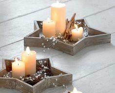 Holzsterne mit Kerzen: