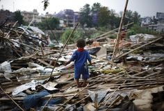 A child stood amid rubble where his house once stood near the banks of Bagmati River in Katmandu, Nepal, Wednesday. Hundreds of people living in the slum are now homeless after their settlement was demolished