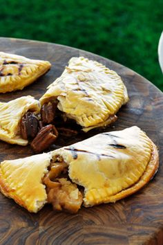 Caramelized peaches wrapped in a buttery crust and then cooked over a charcoal grill until crispy and golden brown? Yes, please. These half-moon pies aren't just delicious; they're also the neatest way to eat a gooey, oozy fruit pocket.