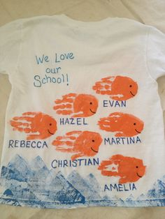 "End of year class t-shirts; handprint fish t-shirts; front side has name of school and year; back side has ""we love our school"""