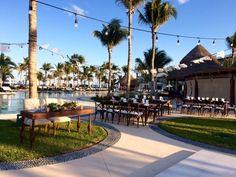 A  beautiful reception, hosted poolside, with gorgeous wooden tables and elegant details #SecretsAkumalRivieraMaya #Mexico #DestinationWedding