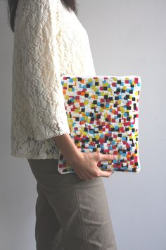 {needlepoint zipper clutch} gorgeous pixelated pattern! handmade in Japan