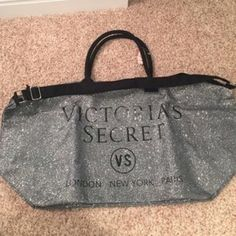 Victoria Secret Weekender Bag Glittery silver weekender bag. Brand New! Still in the plastic with the tag. Just took it out to take a picture. I'm trying to downsize so no trades please! PINK Victoria's Secret Bags Travel Bags