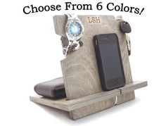 This universal cell phone docking station also holds a wallet, watch, and keys! Handcrafted from Baltic birch, this is truly a unique gift.  Guys are sure to love it!  Proudly made in the USA!