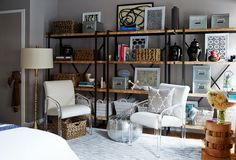 """""""A bookshelf can work in two important ways in a compact apartment: first, as a storage unit, using baskets and boxes, and second, as a display area. Keep the balance two to one storage to display,"""" Andrew advises. Small Space Makeover: A 400-Square-Foot Apartment – One Kings Lane"""