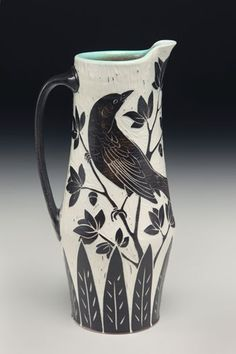 Porcelain Raven Pitcher by Karen Newgard, who uses the sgrafitto carving technique on porcelain, as it preserves the quality & clarity of the image. The wheel thrown pots are finished in a salt kiln that does the glazing & preserves the carved areas / http://karennewgardpottery.com