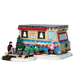 This family of four has taken a Christmas Road Trip in their festively decorated camper. Mom and dad roast marshmallows next to the Christmas Tree, while the children play in the snow!