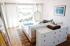 Decor Ideas to Steal from The Surf Lodge - bed in the middle of the room with the dresser to the back and facing a seating area or desk???