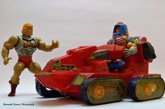 """The Attack Trak, with Battle Armor He-Man and Man-E-Faces action figures. This was a motorized """"treaded"""" vehicle for the Masters of the Universe line of toys in the 1980s."""
