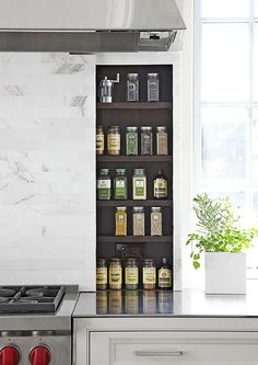 In the range area, sliding panels reveal handy spices. When closed, it's a sleek marble-tile backsplash.