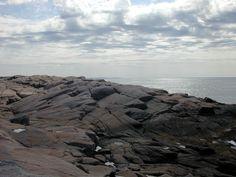 Rocks meet the shore at Peggy's Cove in Nova Scotia, CA. #coastal.  Photo by J. Underwood.