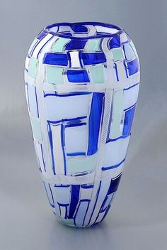 This really lovely large balaster shaped vase was made by Mike Hunter for Twists Glass  in 2010. It is comprised of tessera canes in various shades of blue and white zanfirico canes in a patchwork pattern. There is a very narrow blue incalmo top.  It is signed