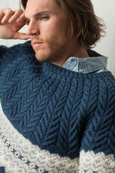 The Bergen Peak Pullover by Irina Anikeeva features updated takes on two classic techniques: Fair Isle and cables. This handsome pullover knitting pattern from Interweave Knits, Spring 2018 has flowing staghorn cables at the yoke and a striking graphic colorwork band. It is worked in the round from the bottom up.