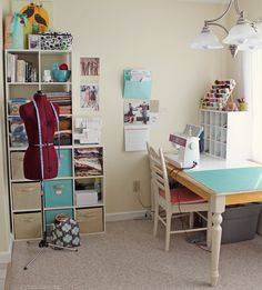 Sweet sewing space. Love the cubbies for fabric storage & notions.