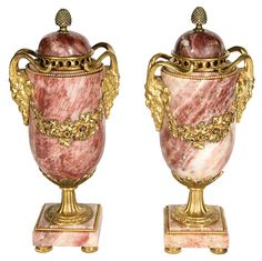 Pair of Stylized 19th Century Urns | From a unique collection of antique and modern vases and vessels at https://www.1stdibs.com/furniture/decorative-objects/vases-vessels/
