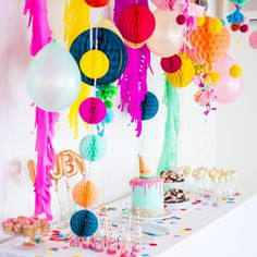 Love this bright and colorful dessert table for a fun baby sprinkle!
