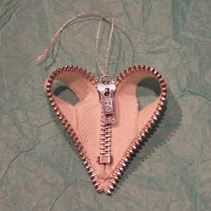 https://flic.kr/p/7hFJs9 | zipper heart ornament | ornament made with a recycled metal zipper. you could probably also make it into a pendant