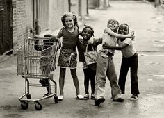"""U.S. A pinner says: """"1973, black and white children goofing around together with a shopping cart. At one time, racism wasn't the point. Friendship was"""""""