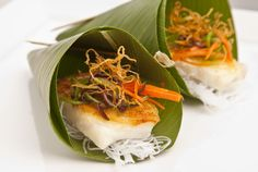 Everyone is loving the Vietnamese food trend right now!  Sea Bass wrapped in a Banana Leaf by Blue Plate Catering in Chicago