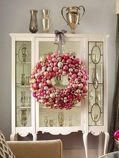 Love everything about this...the wreath, the cabinet, the collection.
