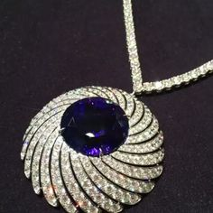 @pleasereturntocesar. A spectacular 66CT round tanzanite on this amazing necklace with over 299 white diamonds