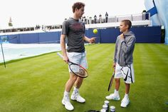 Pin for Later: David Beckham Enjoys Some Sweet Father-Son Bonding With Romeo at a Tennis Match