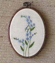 Blue forget me not flowers embroidery hoop art, Floral wall art, Hand embroidered botanical gift for her, Delicate hand stitched wild flower Blau vergiss mich nicht Blumen Stickrahmen Kunst Floral Wand Floral Embroidery Patterns, Hand Embroidery Stitches, Embroidery Hoop Art, Hand Embroidery Designs, Flower Patterns, Cross Stitch Embroidery, Ribbon Embroidery, Knitting Stitches, Embroidered Flowers