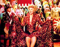 Ginger Rogers puts her stamp on The Saga of Jenny' in the Edith Head dress to beat all dresses and in front of the dazzling Raoul Pene Dubois circus set, in 'Lady in the Dark'