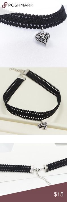 Black choker necklace with silver heart On trend. Black lace like, stretch choker with silver toned hanging heart. Adjustable back. Not restricting. Super cute statement maker!!! Boutique Jewelry Necklaces