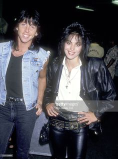 Musician Paul Harkins and Musician Joan Jett attend Billy Idol concert performance on August 5, 1987 at Madison Square Garden in New York City.