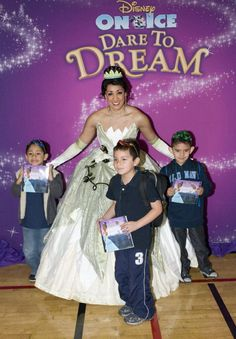 Princess Tiana poses with children from the Fred T. Korematsu Discovery Academy in Oakland