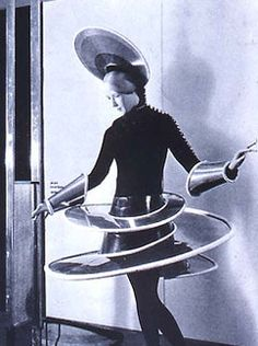 Bauhaus fashion. Photograph by Karl Neumer.  This is innovative and the different use of material for the design is clever. Plasticwith a space aspect.