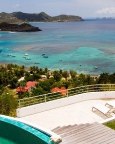 In the hills of Caramuche, Villa REP is a three-bedroom home with views of the Caribbean. #JSIsland