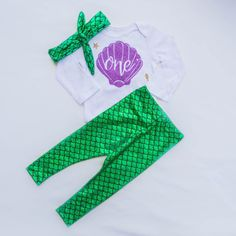 Mermaid First Birthday Outfit - pants, headband and bodysuit! Outfits are similar to Carters sizing. We offer them in SS for Short sleeve and LS for Long sleeve. Our Mermaid Pants are made specially by our Employee Michele who sews each and every item in the shop :) Pants have some stretch and sizing is based off of Carters. If purchasing the Women's top also leave the sizing in the notes at checkout. Thank you so much for shopping handmade we are so glad to have you <3