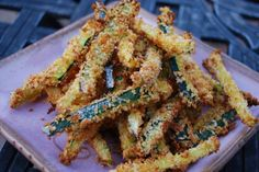 Crispy Parmesan Zucchini Fries~ Slice zucchini into strips. Season with flour, paprika and garlic powder. Roll zucchini strips in flour mixture, dip into egg, drop onto a plate of panko breadcrumbs, Parmesan cheese and a little more paprika and garlic powder. Bake at 425 degrees for 10 minutes, flip bake another 10 minutes.