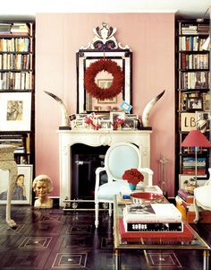 love the blush wall accented with red, sky blue and cream