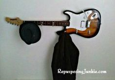 Repurposed electric guitar into coat rack perfect for a music room or office decor